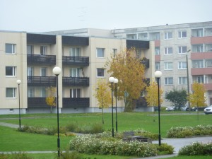 Soviet era apartments with new siding and windows. Note nice lamps and landscaping around the buildings.
